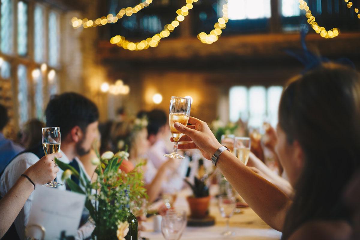 Guests raising glasses at a wedding